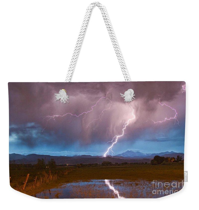 Lightning Weekender Tote Bag featuring the photograph Lightning Striking Longs Peak Foothills 2 by James BO Insogna
