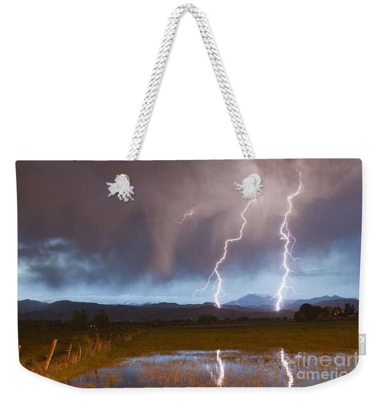 Awesome Weekender Tote Bag featuring the photograph Lightning Striking Longs Peak Foothills by James BO Insogna
