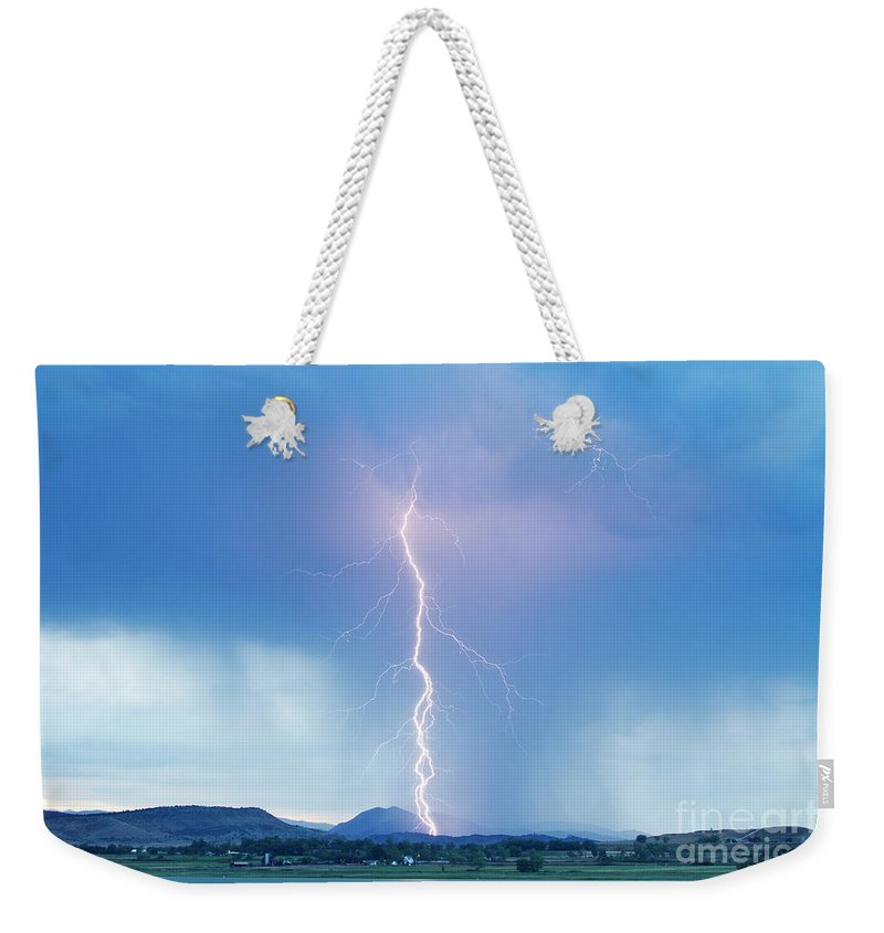 July Weekender Tote Bag featuring the photograph Lightning Twine Striking The Colorado Rocky Mountain Foothills by James BO Insogna