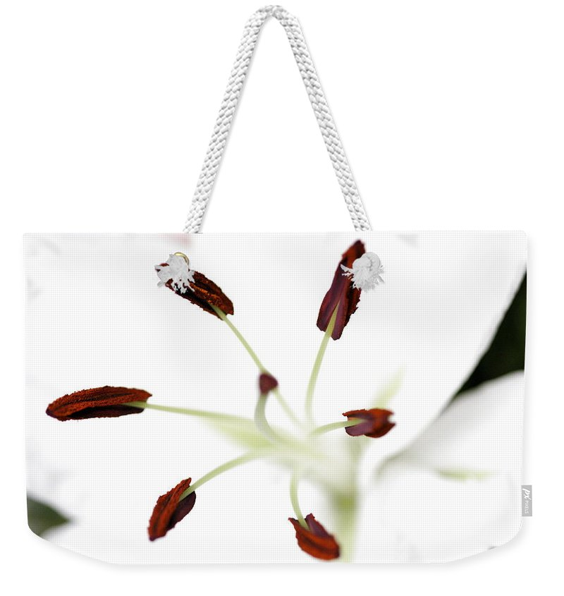 Lily Weekender Tote Bag featuring the photograph Lily Center by Angela Rath
