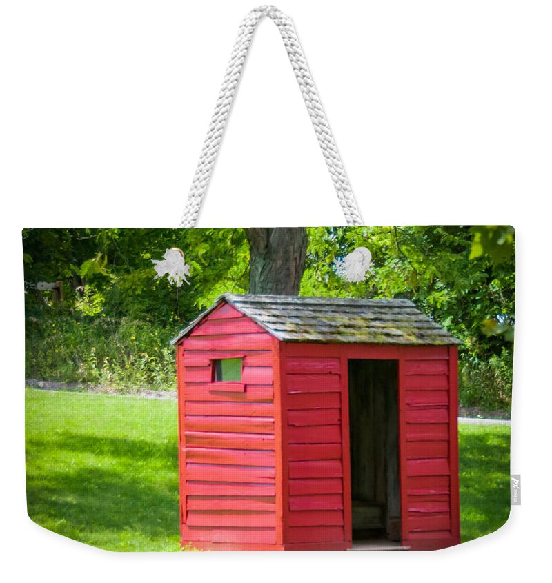Guy Whiteley Photography Weekender Tote Bag featuring the photograph Little Red Three-seater by Guy Whiteley