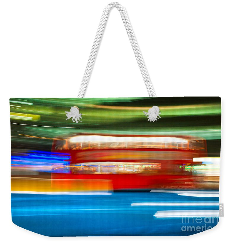 Asphalt Weekender Tote Bag featuring the photograph London Bus Motion by Luciano Mortula
