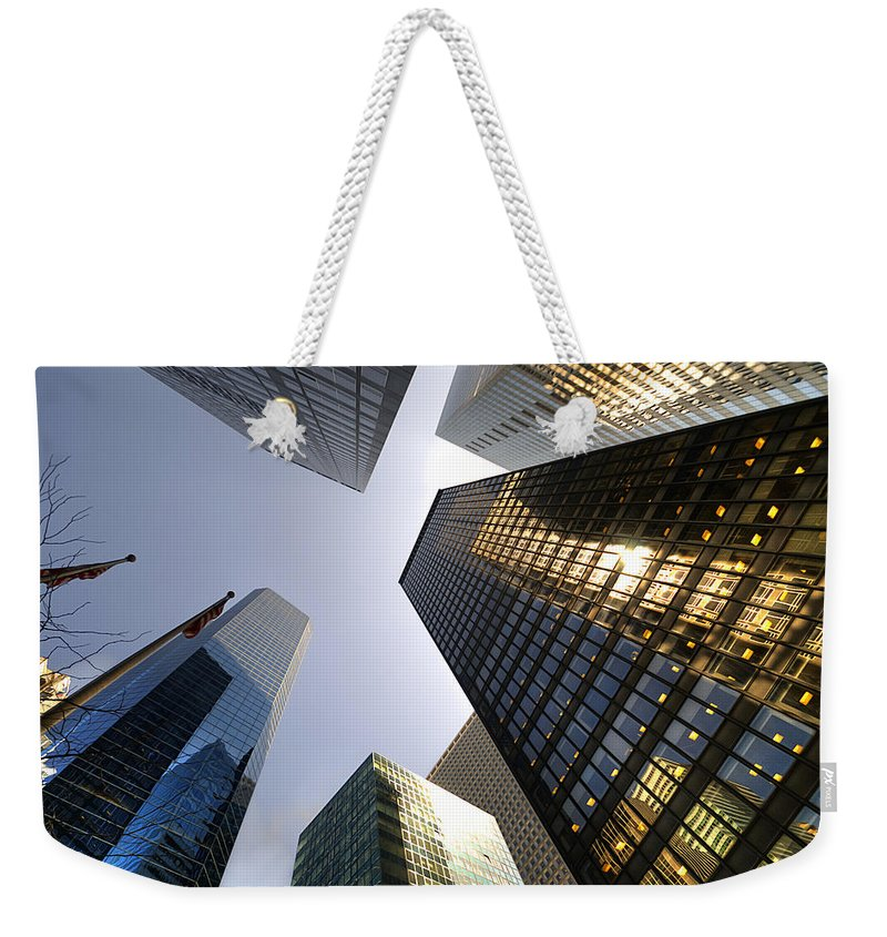 America Weekender Tote Bag featuring the photograph Looking Up by Svetlana Sewell