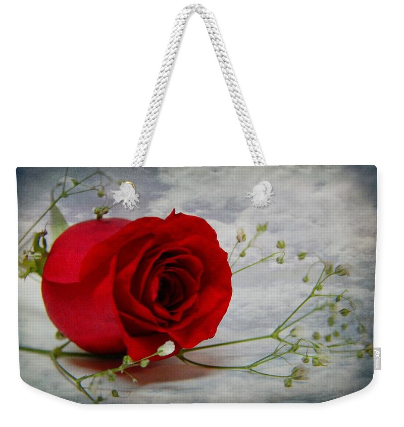 Rose Weekender Tote Bag featuring the photograph Love Is Everlasting by Davandra Cribbie