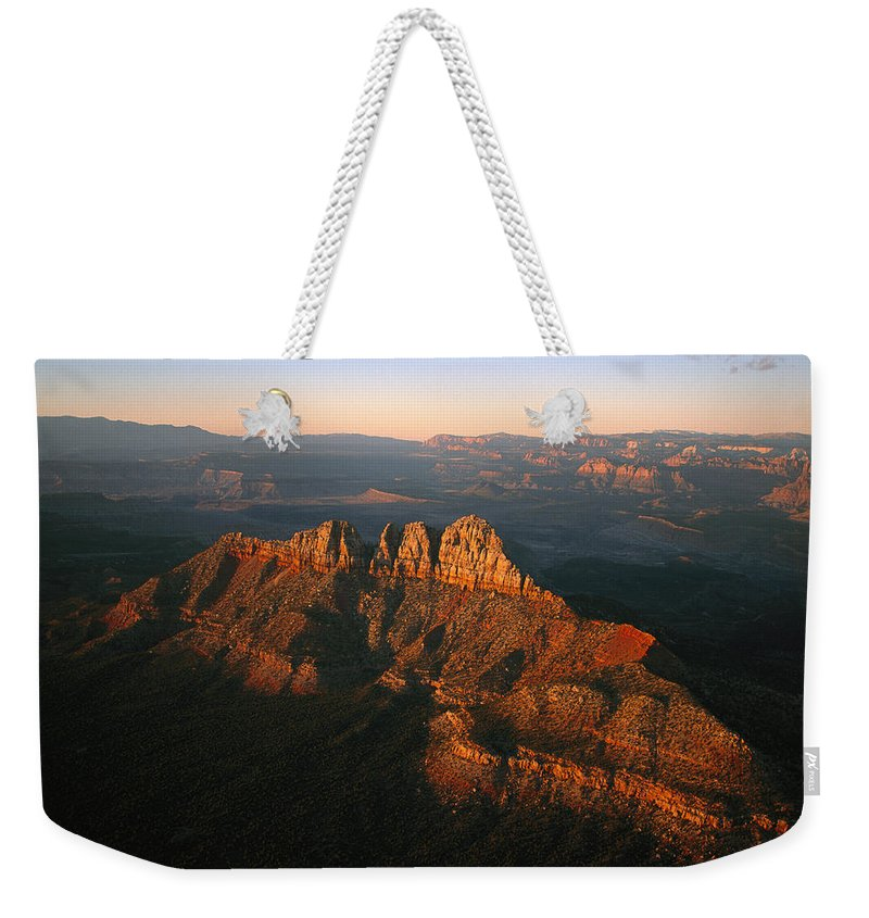 Scenes And Views Weekender Tote Bag featuring the photograph Low Sunlight Shines On Mountains by Melissa Farlow