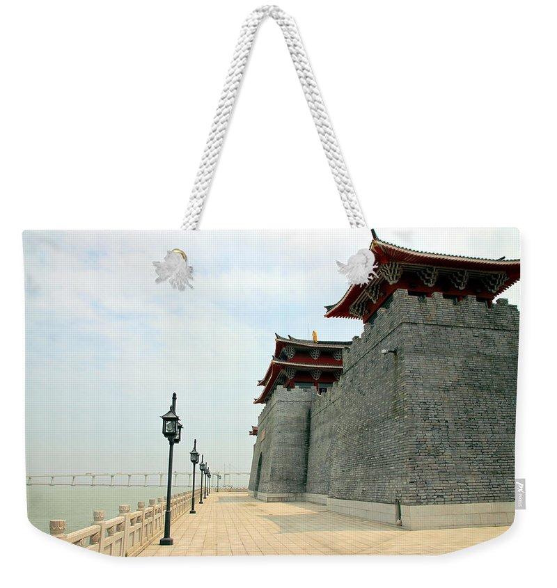 Macau Weekender Tote Bag featuring the photograph Macau Fisherman's Wharf by Valentino Visentini