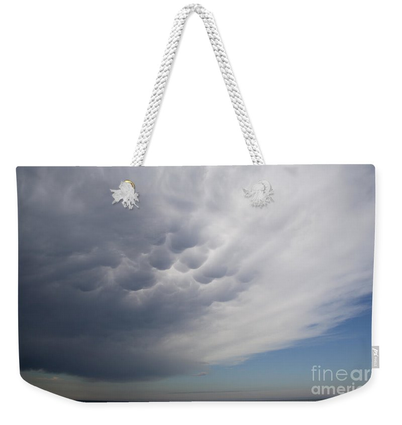 Weather Weekender Tote Bag featuring the photograph Mammatiform Clouds by Ted Kinsman