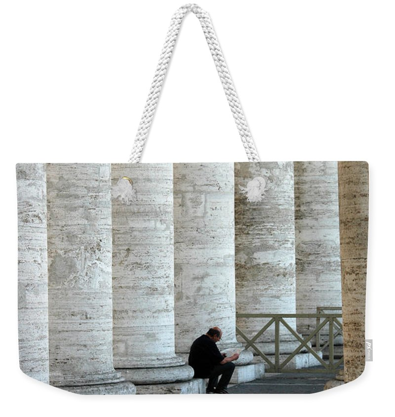 Man Weekender Tote Bag featuring the photograph Man And Columns by Mike Nellums