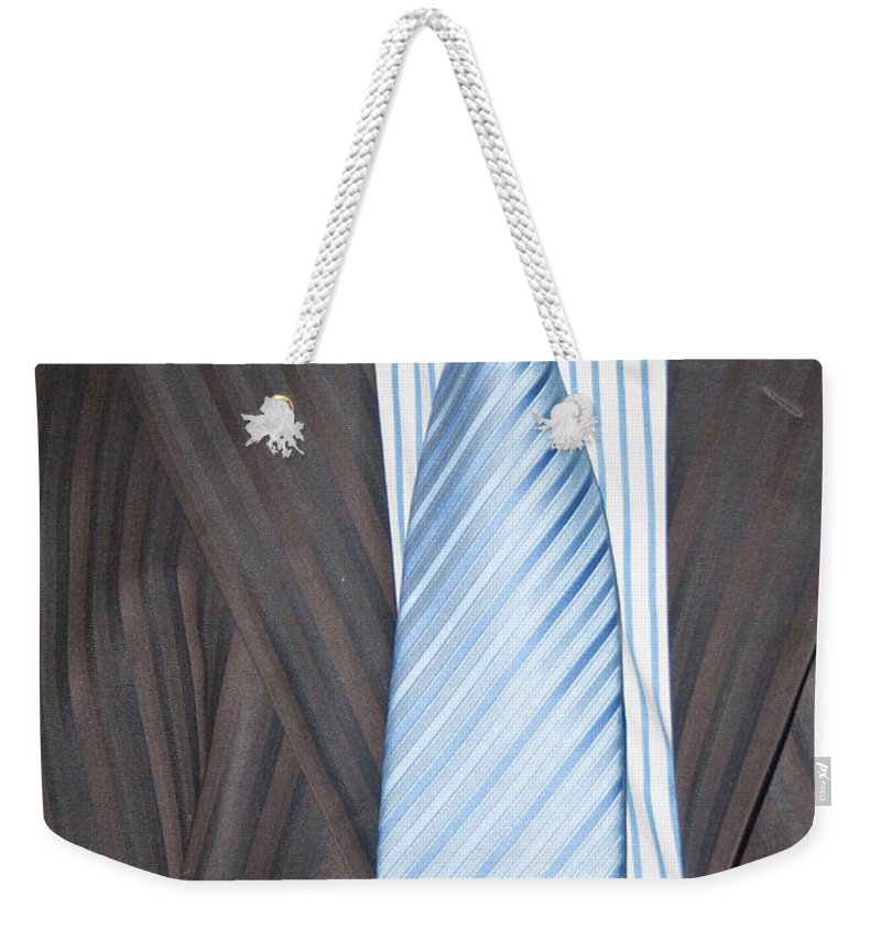 Man Weekender Tote Bag featuring the photograph Man Wearing A Suit And Tie by Ashish Agarwal