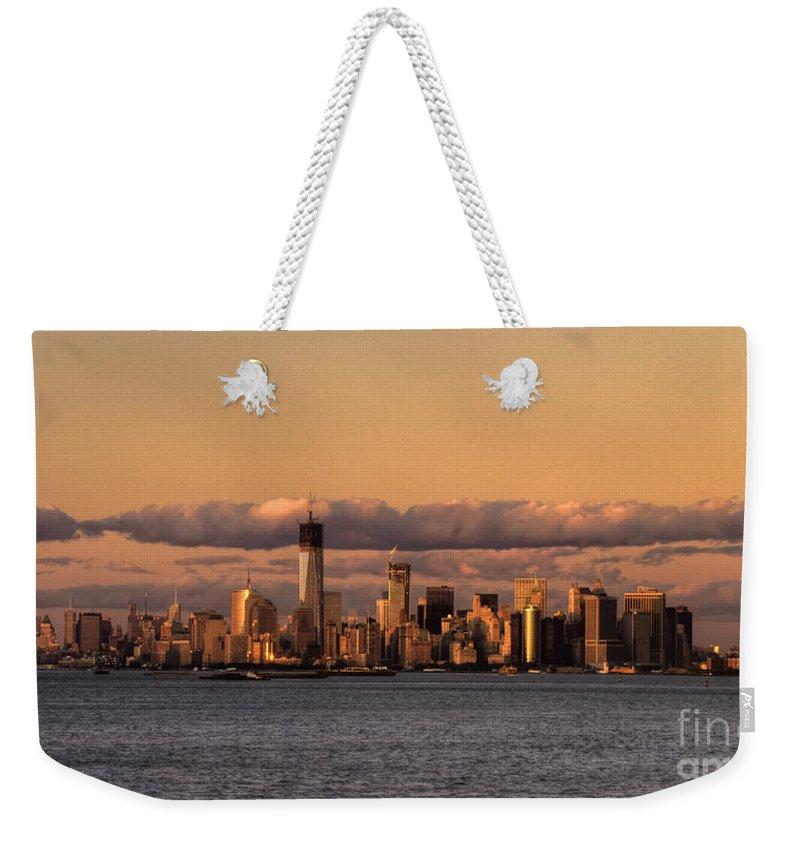 Manhattan Weekender Tote Bag featuring the photograph Manhattan Skyline At Dusk by Rob Hawkins