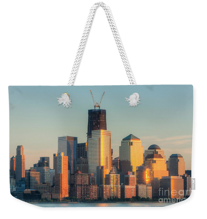Clarence Holmes Weekender Tote Bag featuring the photograph Manhattan Sunset Reflections by Clarence Holmes