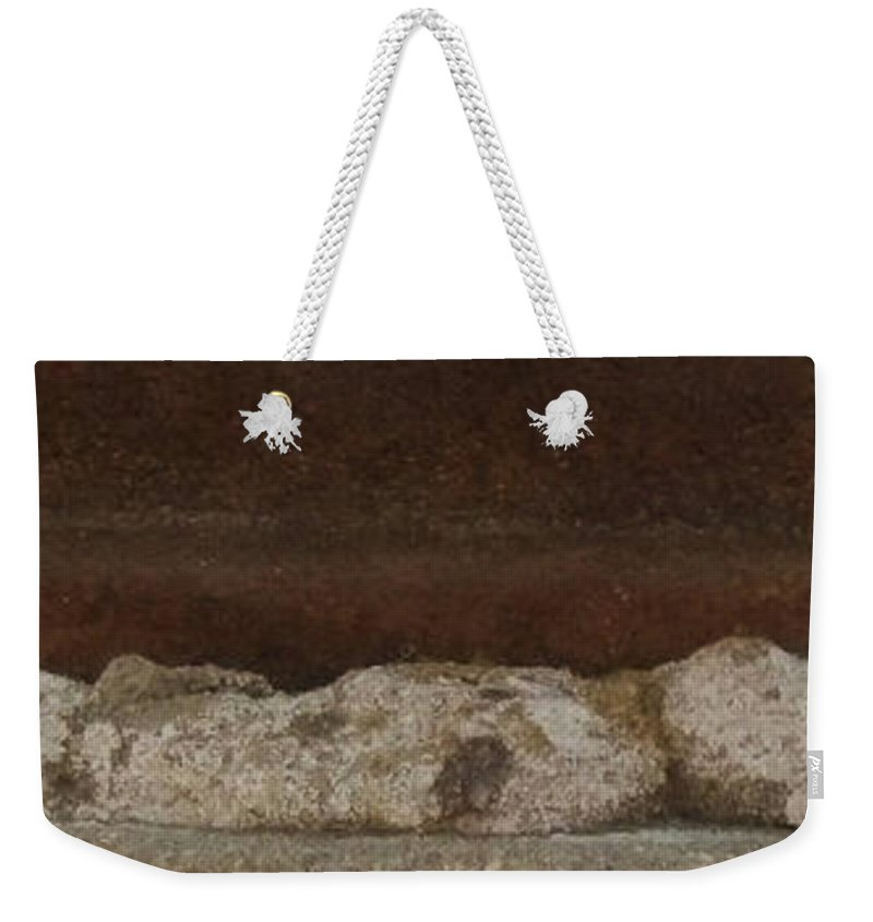 Manhole Cover And Rock Weekender Tote Bag featuring the photograph Manhole Cover And Rock by Jean Moore