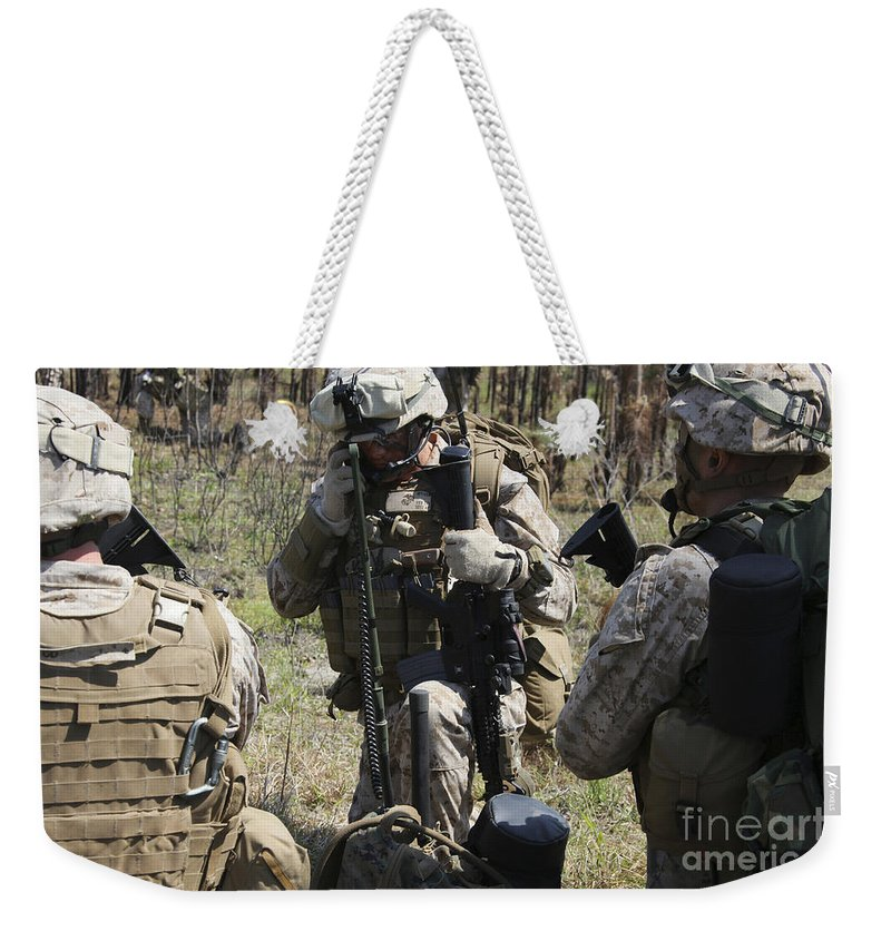 Military Weekender Tote Bag featuring the photograph Marines Communicate With Other Elements by Stocktrek Images
