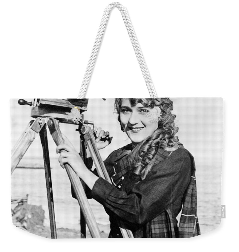 1916 Weekender Tote Bag featuring the photograph Mary Pickford (1893-1979). Born Gladys Mary Smith. American Actress, With A Movie Camera On A Beach, C1916 by Granger