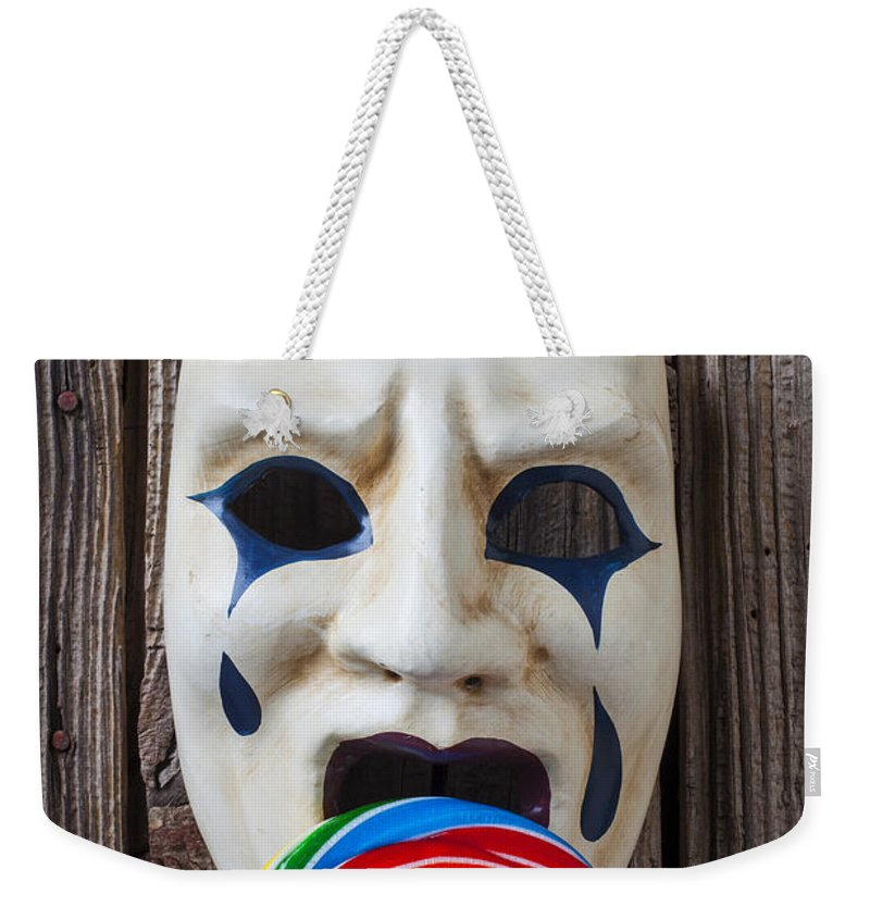 Mask Masks Weekender Tote Bag featuring the photograph Mask Licking Sucker by Garry Gay