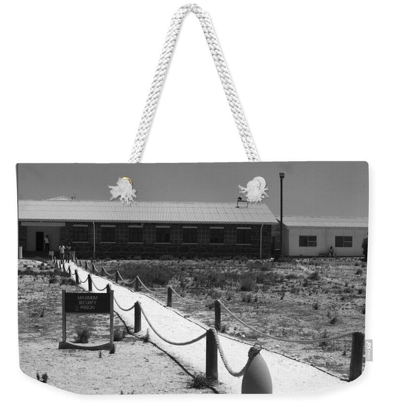 Robben Island Weekender Tote Bag featuring the photograph Maximum Security by Aidan Moran