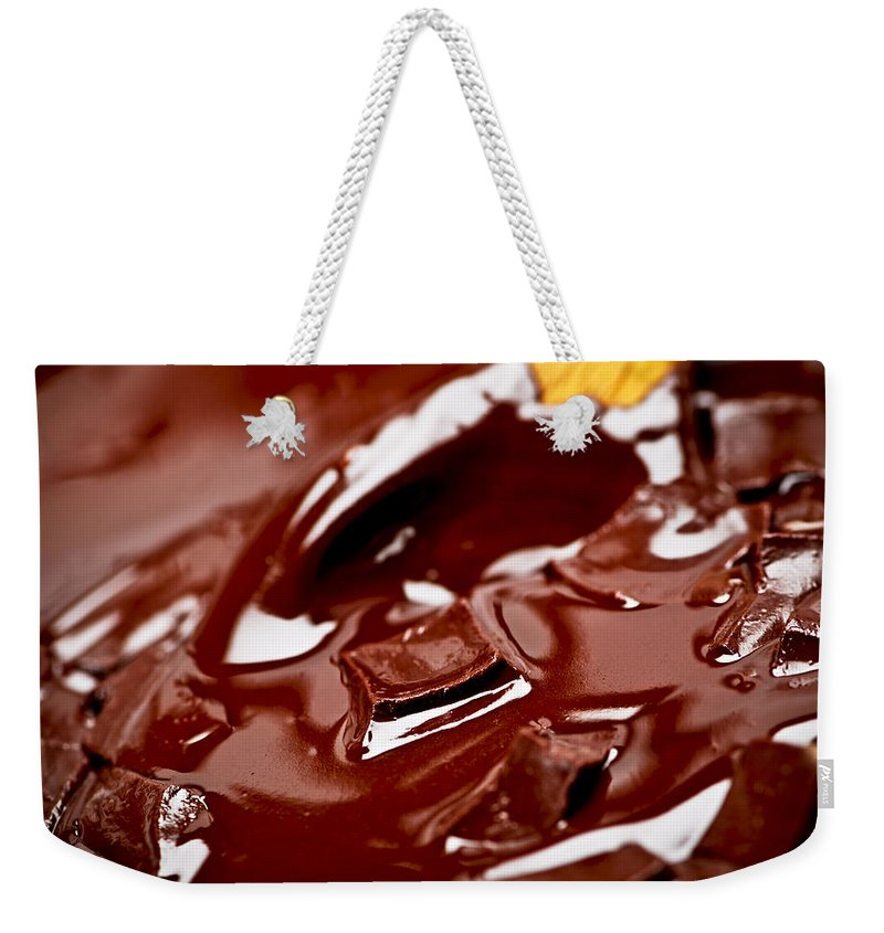 Chocolate Weekender Tote Bag featuring the photograph Melting Chocolate And Spoon by Elena Elisseeva