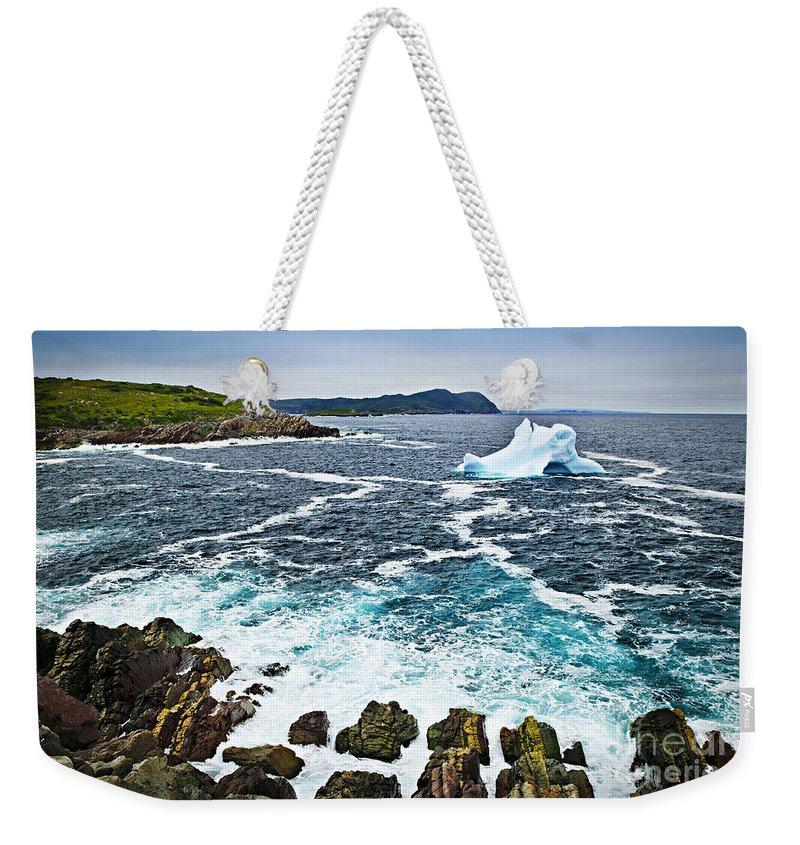 Iceberg Weekender Tote Bag featuring the photograph Melting Iceberg In Newfoundland by Elena Elisseeva