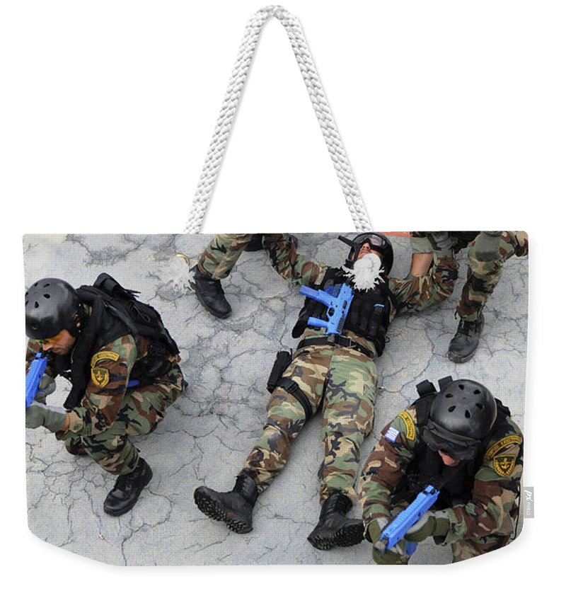 Rescue Weekender Tote Bag featuring the photograph Members Of The Greek Navy Practice by Stocktrek Images
