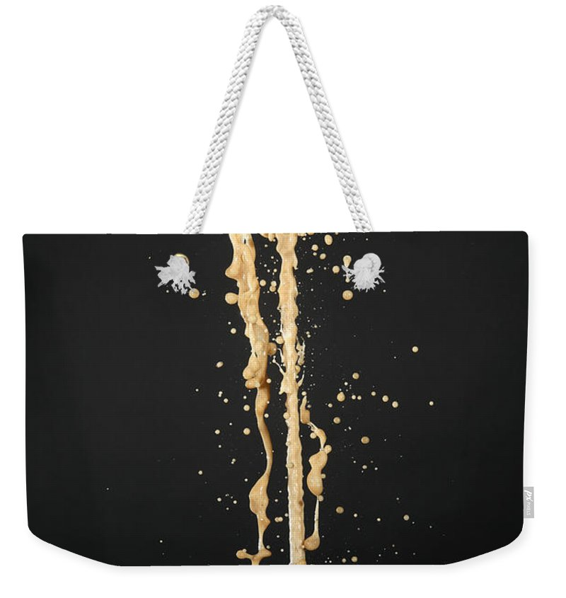 Mentos Weekender Tote Bag featuring the photograph Mentos And Soda Reaction by Ted Kinsman