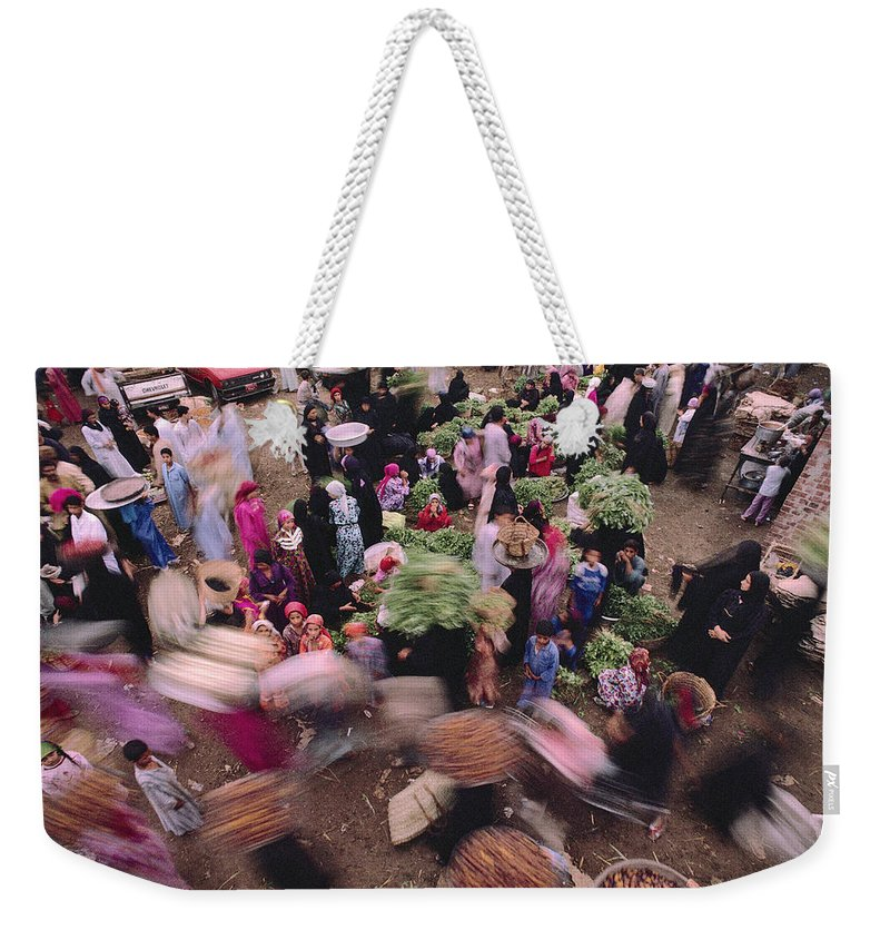 Color Image Weekender Tote Bag featuring the photograph Merchants At Saqqaras Market Carry by Kenneth Garrett