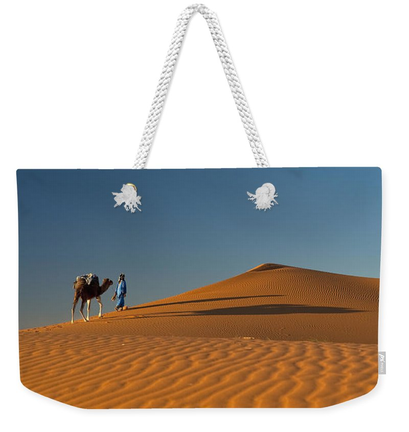 Young Man Weekender Tote Bag featuring the photograph Merzouga, Morocco by Axiom Photographic