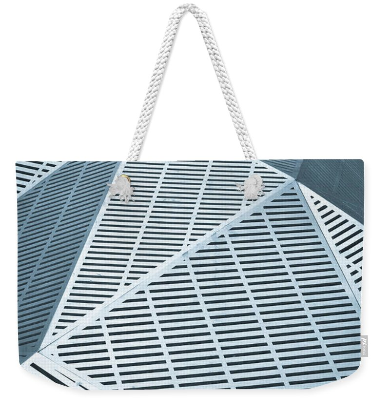 3-d Weekender Tote Bag featuring the photograph Metallic Frames by Tom Gowanlock