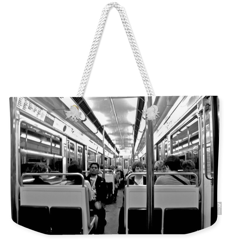 Paris Weekender Tote Bag featuring the photograph Metro Ride by Eric Tressler