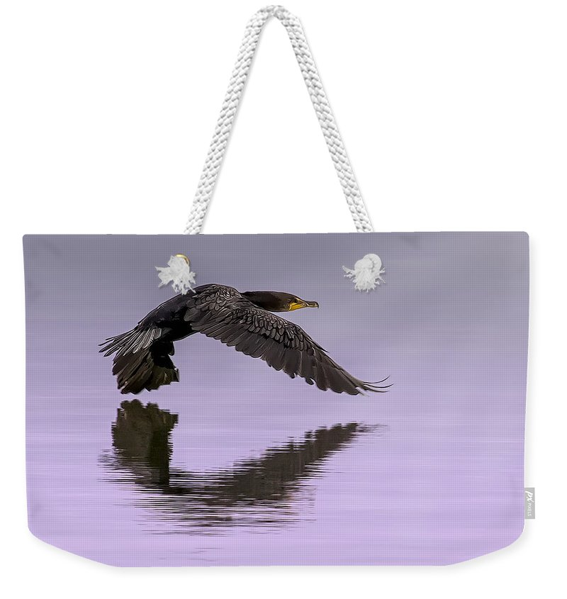 Cormorant Weekender Tote Bag featuring the photograph Midnight Run by Janet Fikar