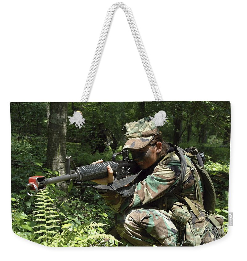 Virginia Weekender Tote Bag featuring the photograph Midshipman Participates In A Combat by Stocktrek Images