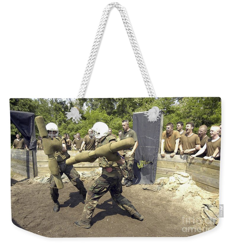 Navy Weekender Tote Bag featuring the photograph Midshipmen Battle With Pugil Sticks by Stocktrek Images