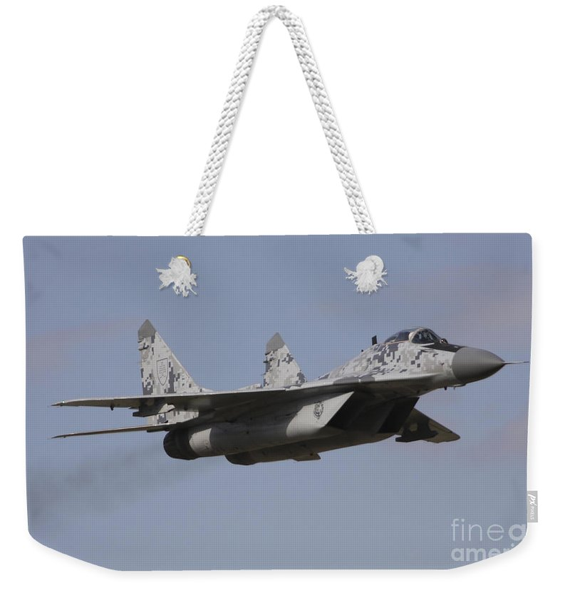 Horizontal Weekender Tote Bag featuring the photograph Mig-29 Of The Slovak Air Force by Timm Ziegenthaler