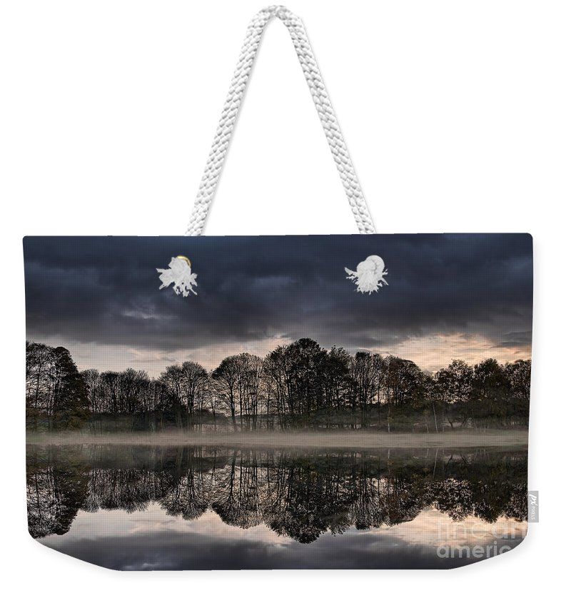 Tree Reflections Weekender Tote Bag featuring the photograph Mirrored Trees by Ann Garrett