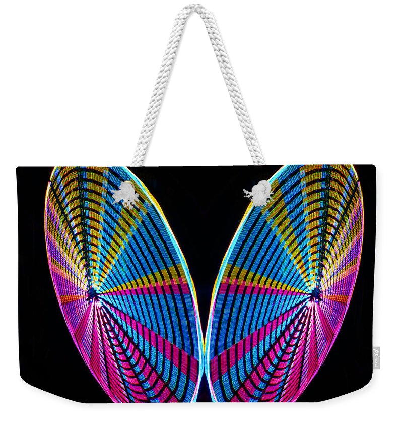 Abstract Weekender Tote Bag featuring the photograph Mirrored Wheel by Rich Walter
