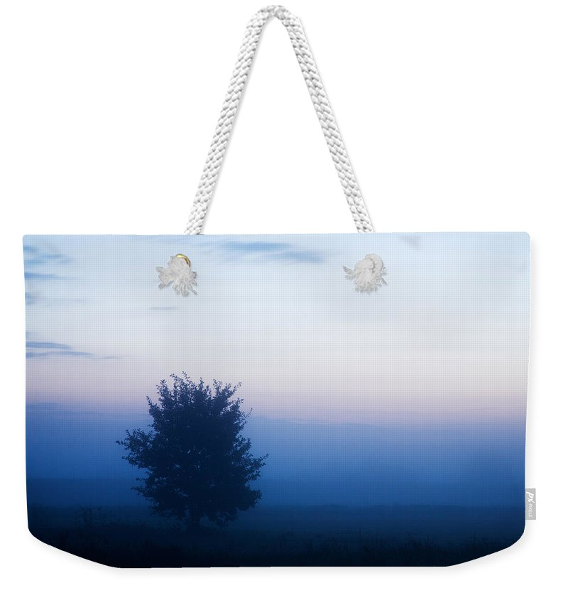 Mountain Weekender Tote Bag featuring the photograph Misty Sunrise by Ian Middleton