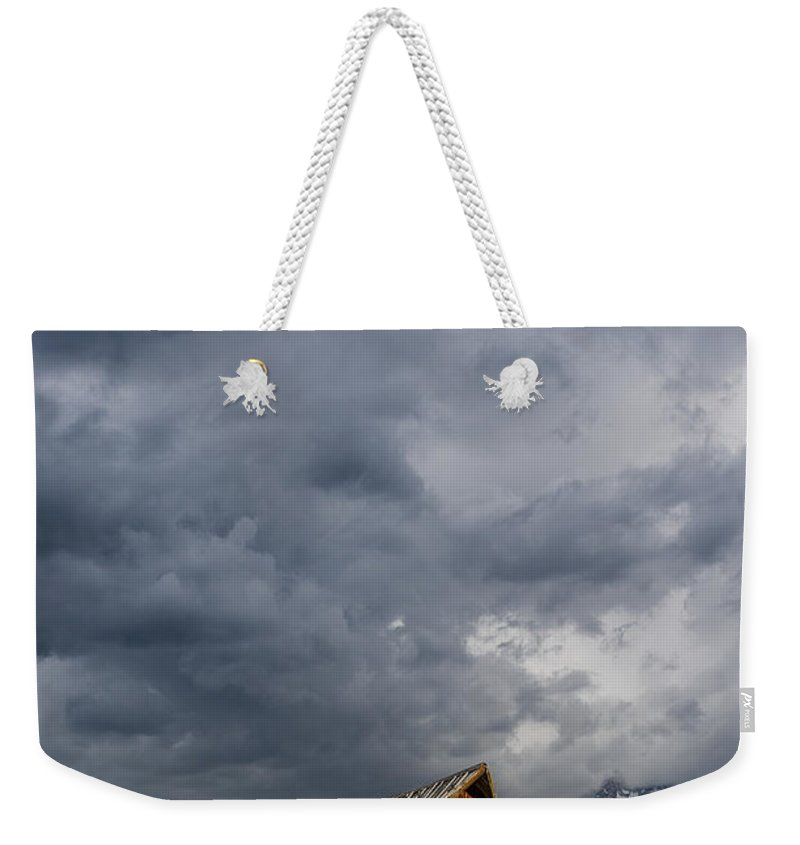 Grand Tetons National Park Weekender Tote Bag featuring the photograph Molton Barn And Approaching Storm by Greg Nyquist