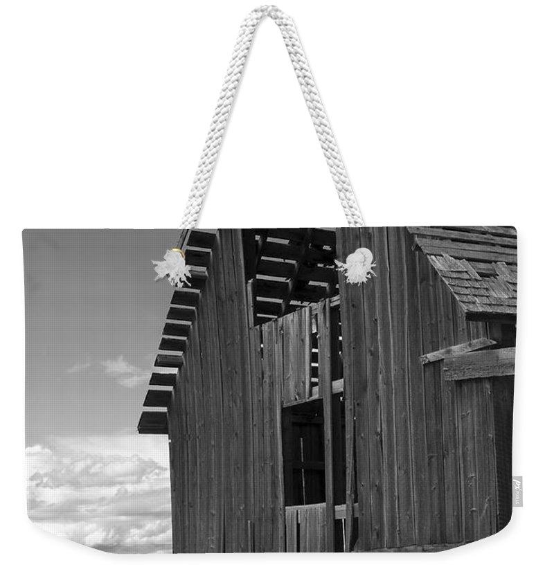 Sandra Bronstein Weekender Tote Bag featuring the photograph Montana Weathered Barn by Sandra Bronstein