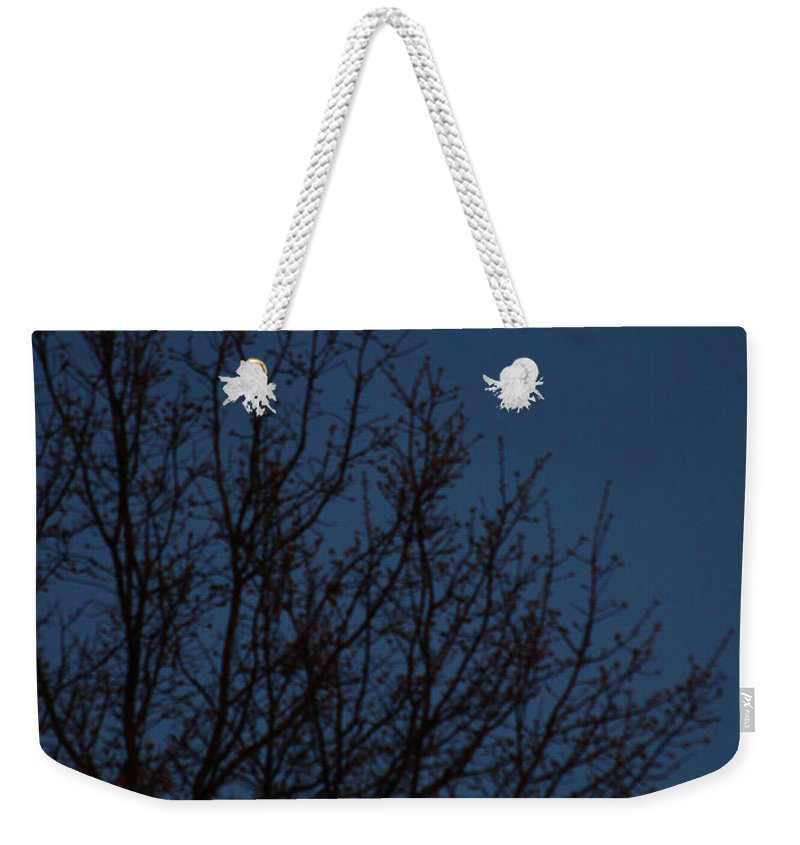 Moon Weekender Tote Bag featuring the photograph Moon And Trees by Mike Nellums