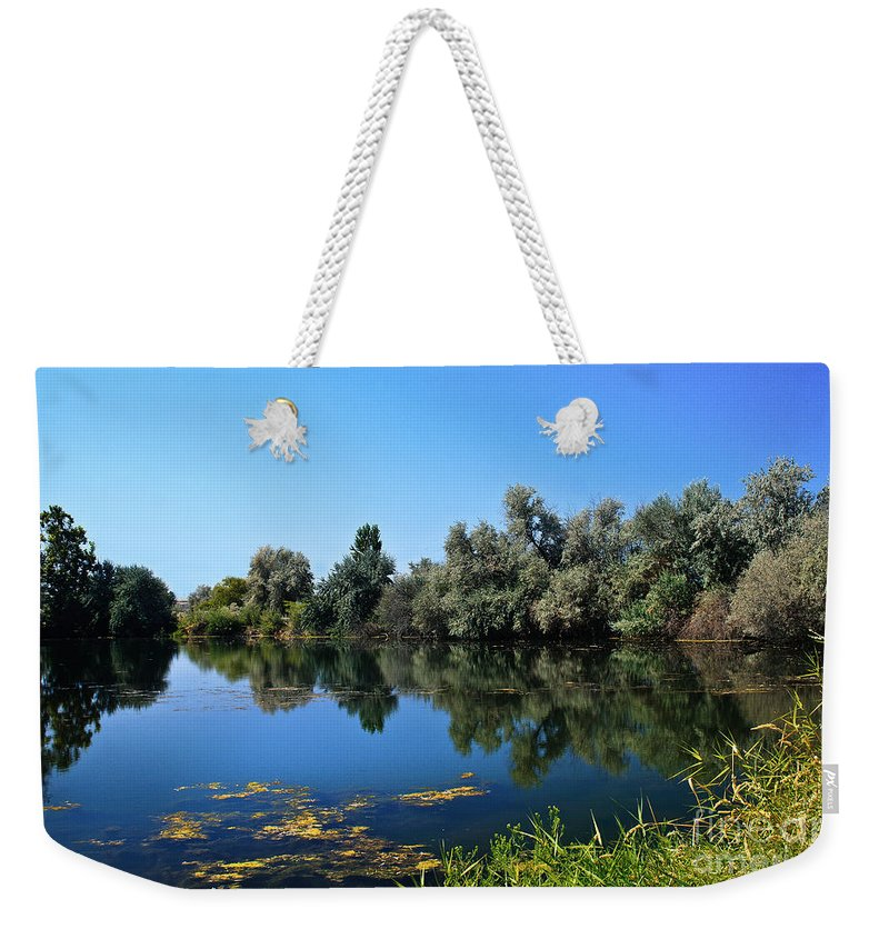 Lake Weekender Tote Bag featuring the photograph Morning Reflection by Robert Bales