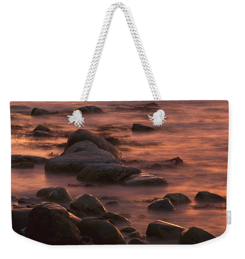 00760114 Weekender Tote Bag featuring the photograph Morning Sun Reflecting In Rocky Water by Christian Ziegler