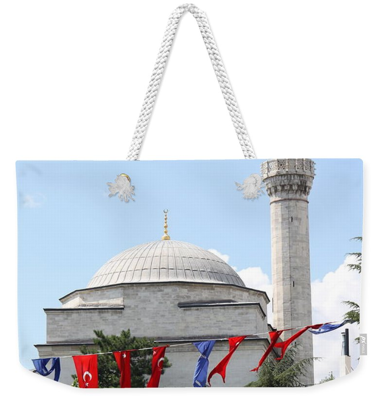 Mosque Weekender Tote Bag featuring the photograph Mosque And Flags by Christiane Schulze Art And Photography