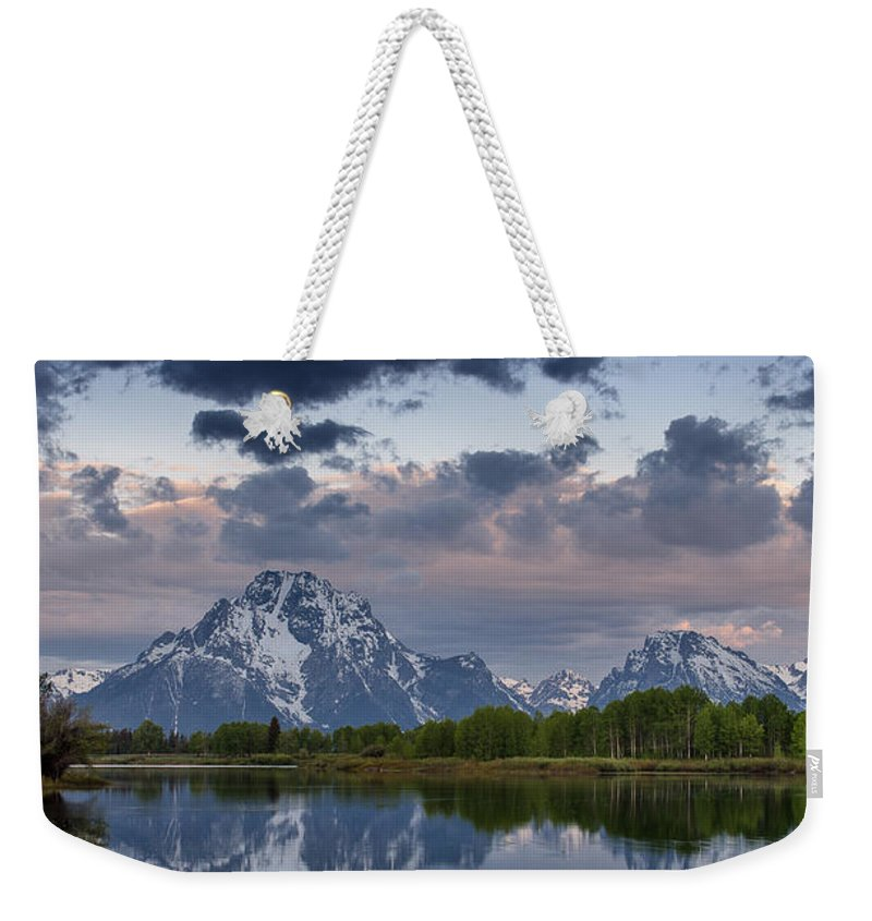 Grand Tetons National Park Weekender Tote Bag featuring the photograph Mount Moran Under Black Cloud by Greg Nyquist