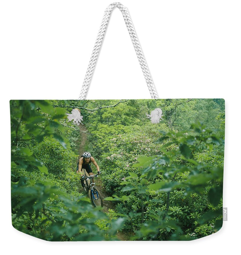 Rhododendron Species Weekender Tote Bag featuring the photograph Mountain Biker On Single Track Trail by Skip Brown