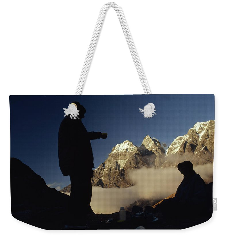 Color Image Weekender Tote Bag featuring the photograph Mountaineers Rest At Their Campsite by Gordon Wiltsie