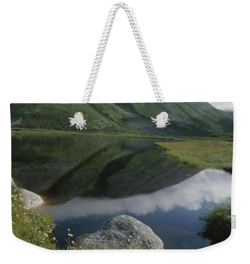 North America Weekender Tote Bag featuring the photograph Mountains And Clouds Are Reflected by Michael S. Lewis