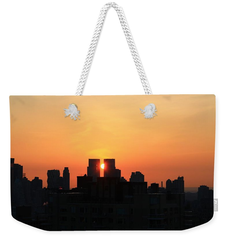 Sunset Weekender Tote Bag featuring the photograph Moving Right by Catie Canetti