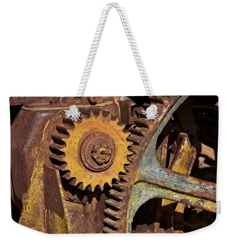 Gears Weekender Tote Bag featuring the photograph Mud Caked Gears by Phyllis Denton