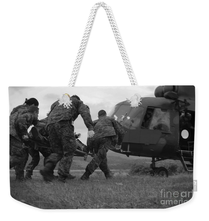 Medceur 2011 Weekender Tote Bag featuring the photograph Multinational Medical Personnel Race by Stocktrek Images