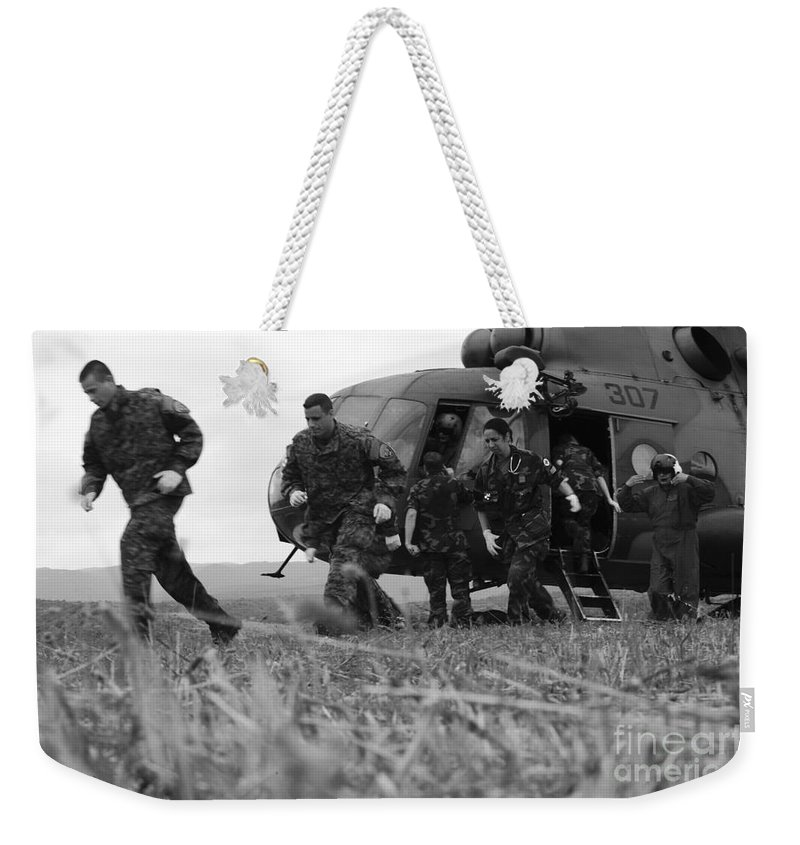 Medceur 2011 Weekender Tote Bag featuring the photograph Multinational Medical Personnel Retreat by Stocktrek Images