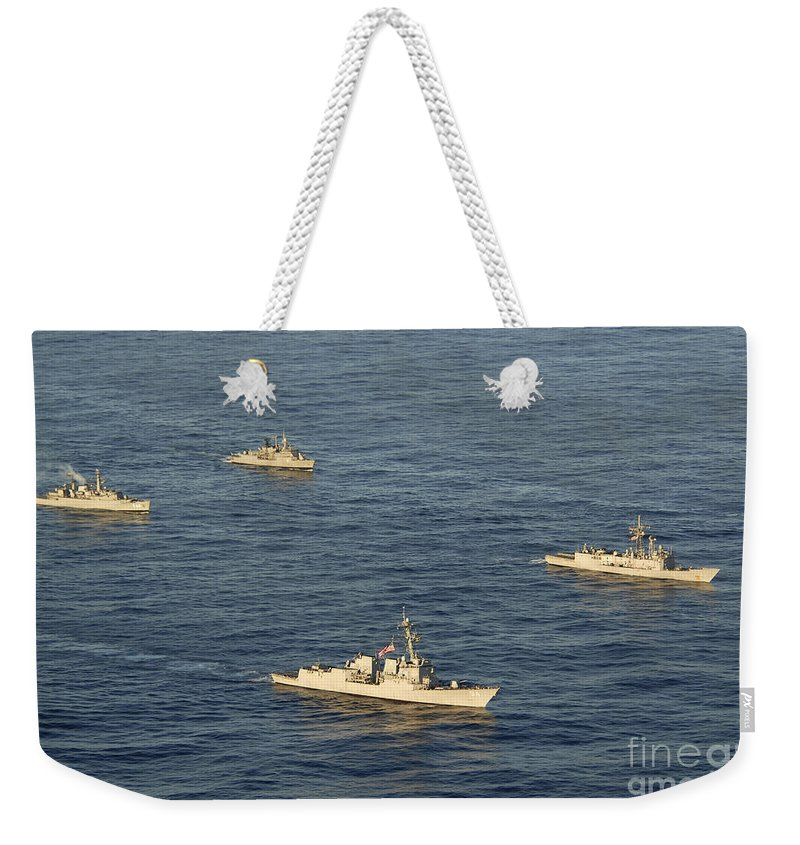 Unitas 52 Weekender Tote Bag featuring the photograph Multinational Navy Ships Move by Stocktrek Images